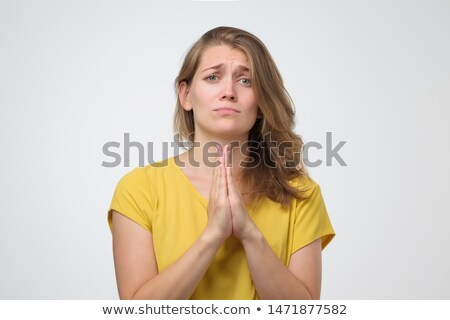 Young woman begging stock photo © fahrner