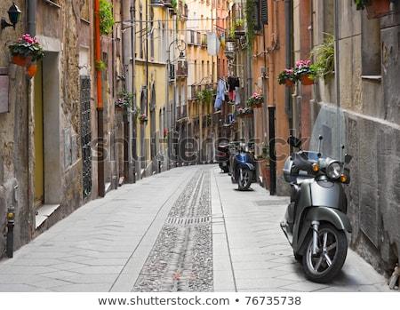 Italian street with parked motorcycles Stock photo © dashapetrenko