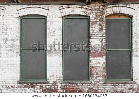 detail of 3 windows in an abandoned industrial building          Stock photo © Melvin07
