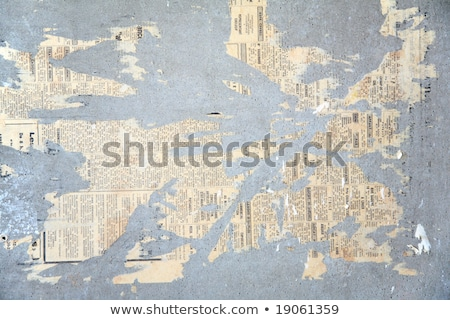 Scraps of pasted newspaper on wall Stock photo © Paha_L