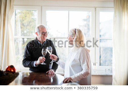 Idősebb pár iszik pezsgő nő család Stock fotó © photography33