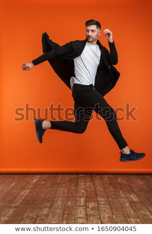 Full length of an attractive masculine man Stock photo © get4net