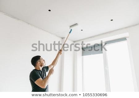 trabalhador · teto · luvas · trabalhar · casa · quarto - foto stock © photography33