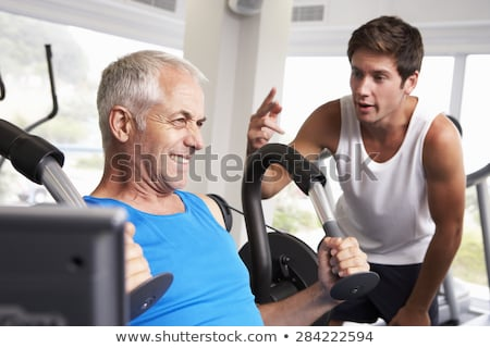 Middle-aged man with personal trainer Stock photo © photography33