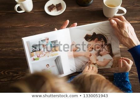 madre · bambini · guardando · photo · album · camera · da · letto · donna - foto d'archivio © photography33