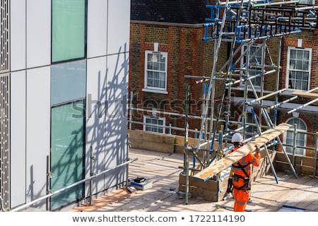 Labourer carrying a wooden plank Stock photo © photography33