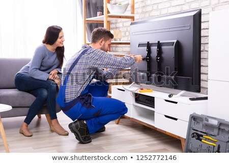 Woman fixing a television Stock photo © photography33