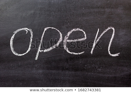 The word 'Open' handwritten with white chalk on a blackboard Stock photo © nenovbrothers