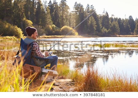 Homme pêche voyage poissons bateau Photo stock © photography33