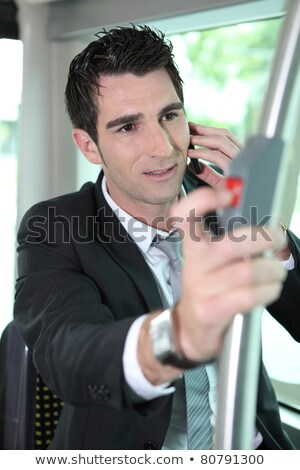 Man pressing stop bell on a tram Stock photo © photography33