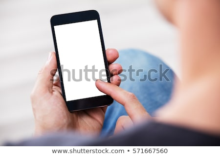 Men showing screen of cell phone, focus on smartphone Stock photo © adamr