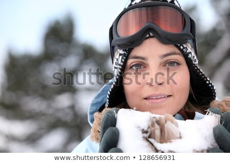 Skier holding snow containing jagged wood Stock photo © photography33