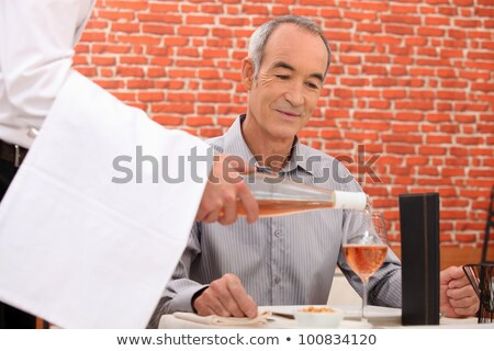 retiree at restaurant with sommelier Stock photo © photography33