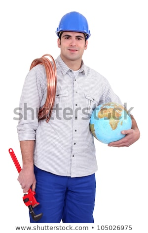 Tradesman holding a globe, a coiled copper wire and a pipe wrench Stock photo © photography33