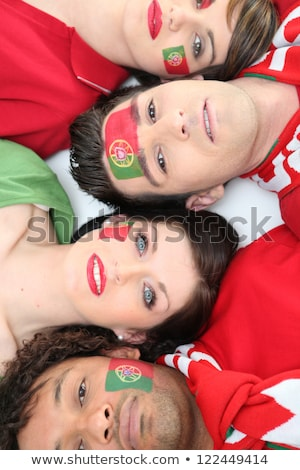 Four Portuguese soccer fans laying down together Stock photo © photography33