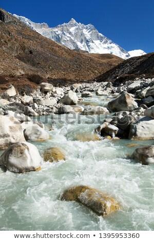 Himalayas: stream and Lhotse, Lhotse shar peaks Stock photo © Arsgera