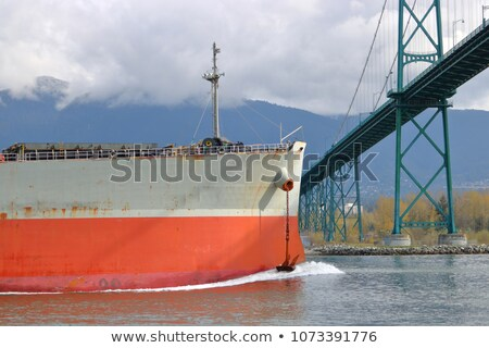 cargo ship approaching or entering the harbor stock photo © experimental