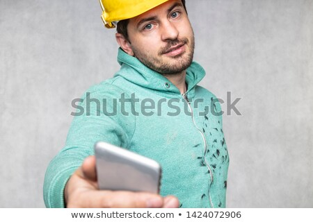 Architect with a phone but listening to you Stock photo © photography33