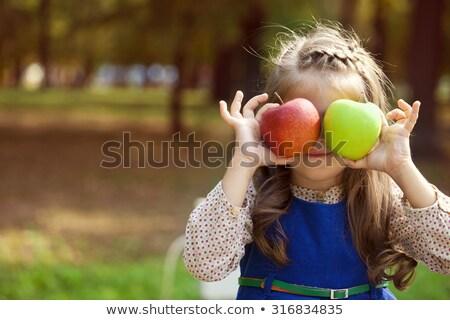 mulher · jovem · dois · maçãs · sorridente · feliz - foto stock © lithian