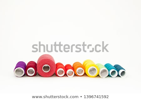 red pink and purple bobbin with thread Stock photo © compuinfoto