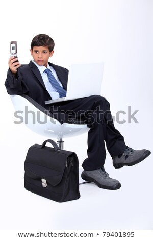 Young boy dressed as a surly businessman Stock photo © photography33
