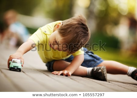 Stok fotoğraf: Little Boy Playing With Toy Cars