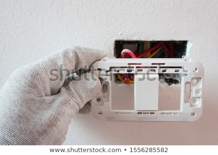 woman repairing an electrical outlet stock photo © photography33