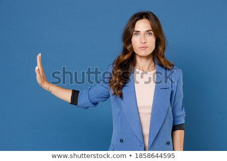 Attractive young model gesturing a mock call Stock photo © stockyimages