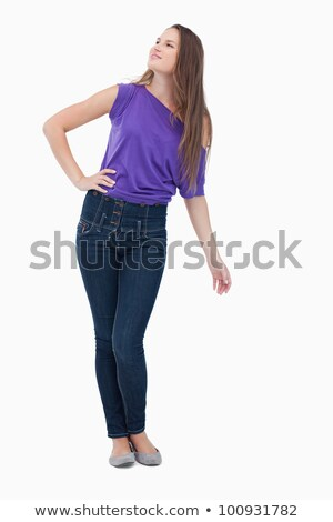 Teenager looking far ahead while her hand is on her hip Stock photo © wavebreak_media