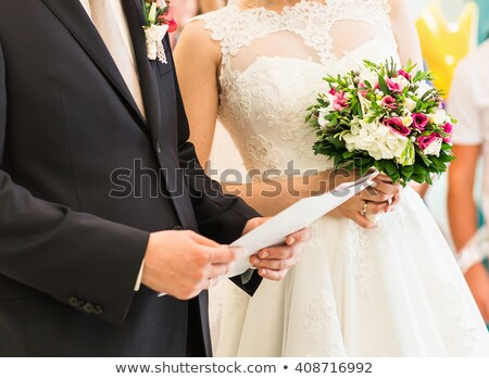 bridegroom signing marriage license or wedding contract  Stock photo © inxti