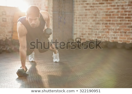Kettlebell dumbbell - fitness man lifting weight Stock photo © Maridav