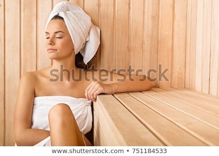 Kadın sauna genç kadın oturma ahşap bank Stok fotoğraf © Aikon