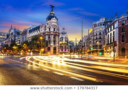 rays of traffic lights on gran via street stock photo © vwalakte