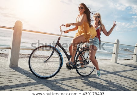 Attractive girls on bicycle Stock photo © Aikon
