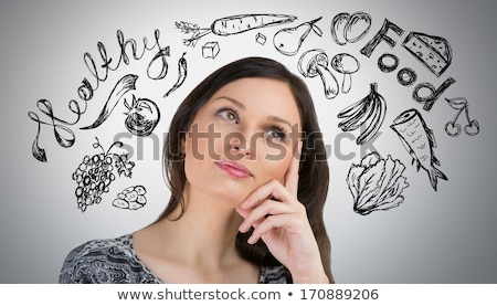 Young pretty woman thinking of healthy food closeup face portrai Stock photo © hasloo