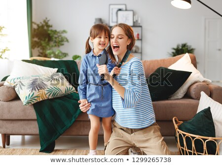 Mother with infant and hairbrushes Stock photo © runzelkorn