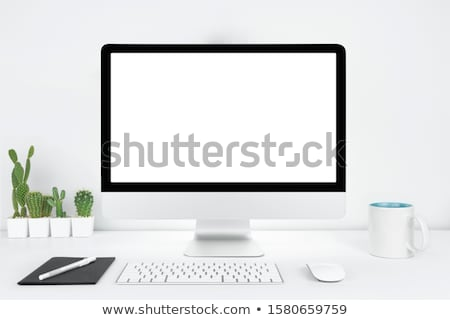 white laptop on table   place for text stock photo © luckyraccoon