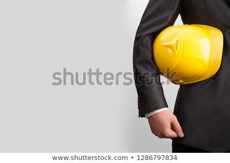 építőmunkás · védősisak · kar · közelkép · tart · munkavédelmi · sisak - stock fotó © jackethead