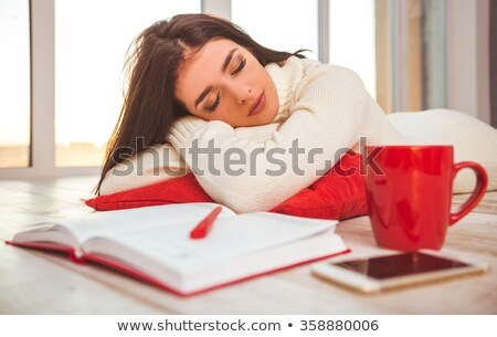 Beautiful young woman standing on a red carpet and dreaming Stock photo © Nejron
