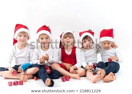 Kislány mikulás kalap nagy karácsony ajándék Stock fotó © stryjek