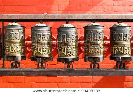Stockfoto: Prayer Wheels In Front Of Buddhist Temple