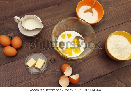 vintage old wooden mixing spoons and other cooking utensils stock photo © feelphotoart
