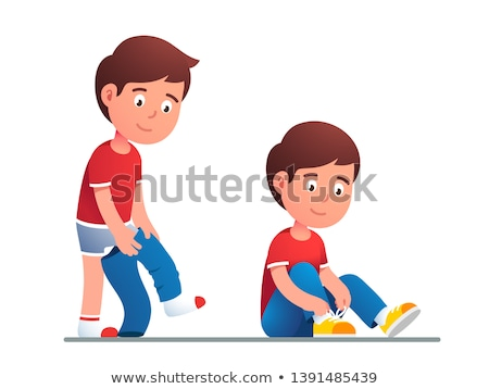 Stock photo: Taking Off Shoes