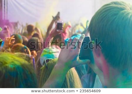 Férfi elvesz fotó mobiltelefon szín fesztivál Stock fotó © dashapetrenko