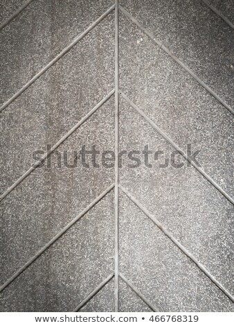 brown paving slabs lined with squares of different value and rectangles stock photo © tashatuvango