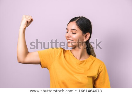 pretty woman showing her biceps against white stock photo © juniart