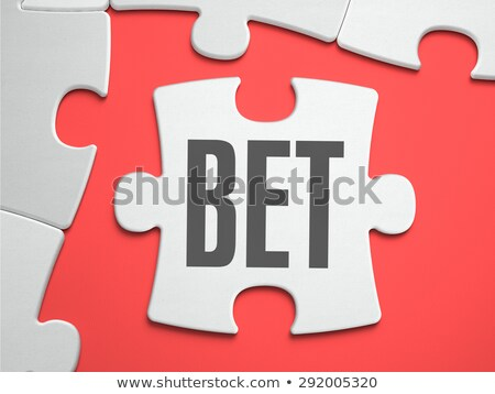 Bet - Puzzle on the Place of Missing Pieces. Stock photo © tashatuvango