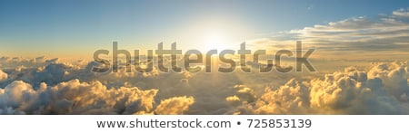 Dawn over the mountains with clouds stock photo © All32