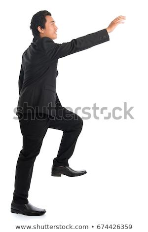 Stock fotó: üzletember · mászik · valami · izolált · férfi · test