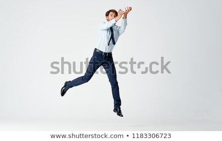Stock fotó: üzletember · zsákmány · valami · izolált · férfi · boldog